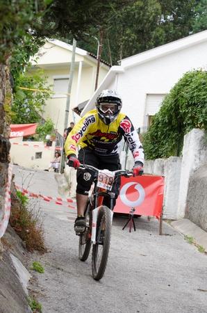 PENACOVA, PORTUGAL - MAY 27: Pedro Jacinto during the Taca de Portugal Downhill Urbano Vodafone on may 27, 2012 in Penacova, Portugal. Stock Photo - 13795673
