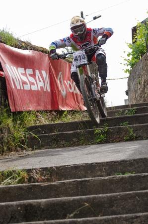 btt: PENACOVA, PORTUGAL - MAY 27: Jose Rodrigues during the Taca de Portugal Downhill Urbano Vodafone on may 27, 2012 in Penacova, Portugal.