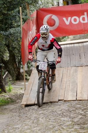 btt: PENACOVA, PORTUGAL - MAY 27: Telmo Oliveira during the Taca de Portugal Downhill Urbano Vodafone on may 27, 2012 in Penacova, Portugal. Editorial