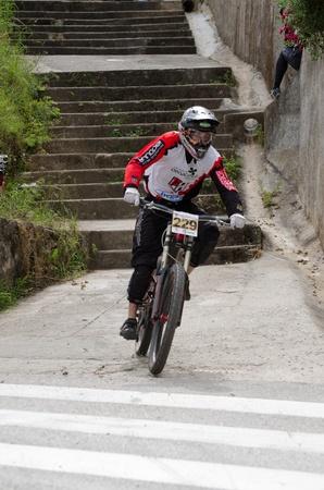 PENACOVA, PORTUGAL - MAY 27: Marco Cordeiro during the Taca de Portugal Downhill Urbano Vodafone on may 27, 2012 in Penacova, Portugal. Stock Photo - 13824349