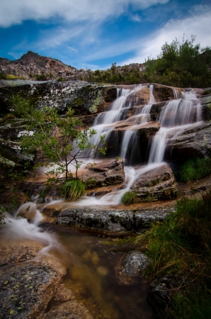 Beautiful waterfall in the National Park of Serra da Estrela in Portugal. photo