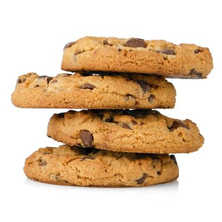 galletas: Pila de galletas de chocolate aisladas sobre fondo blanco. Foto de archivo