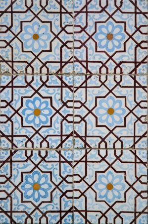 Traditional colored decorative tiles covering many buildings in Lisbon, Portugal photo