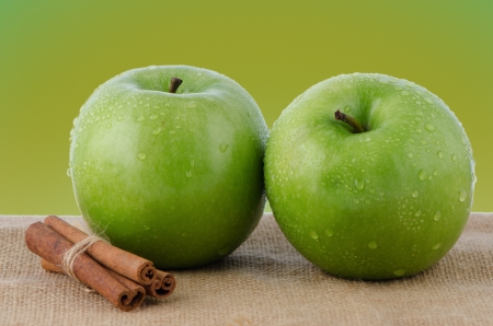 Two fresh green apples on green background. photo