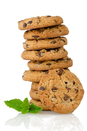 Chocolate cookies with mint leaves isolated on white background.