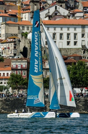 PORTO, PORTUGAL - JULY 07: Oman Air compete in the Extreme Sailing Series boat race on july 07, 2012 in Porto, Portugal. Stock Photo - 14340229