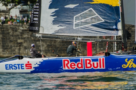 PORTO, PORTUGAL - JULY 07: Red Bull Sailing Team compete in the Extreme Sailing Series boat race on july 07, 2012 in Porto, Portugal. Stock Photo - 14340165