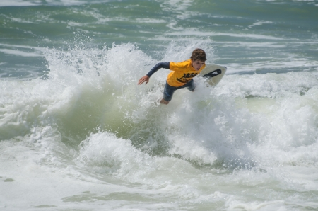 skimming: ESPINHO, PORTUGAL - JULY 08: Participant in the Exile Skim Norte Open 2012 on july 08, 2012 in Espinho, Portugal.