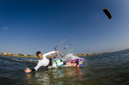 Kiteboarder enjoy surfing on a sunny day. photo