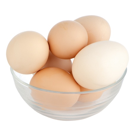Eggs in glass bowl isolated on the white background. photo