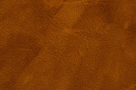 american football background: brown leather texture closeup detailed background.
