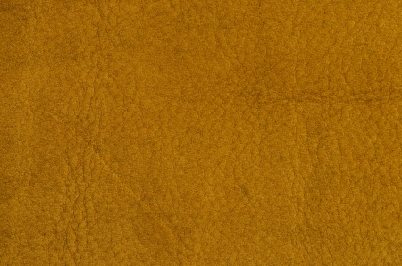 Yellow leather texture closeup detailed background. photo