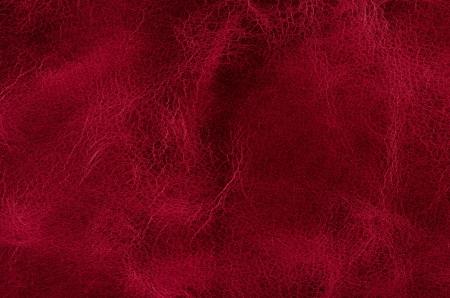 赤い革の質感のクローズ アップの詳細背景。