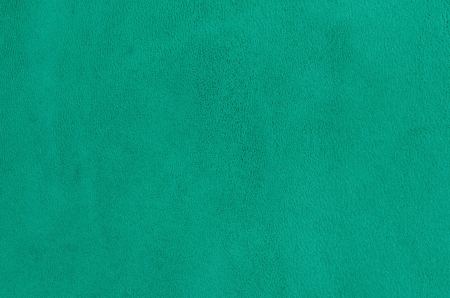 Closeup of natural background - green suede.