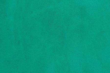 Nahaufnahme natürlichen Hintergrund - grünem Wildleder.
