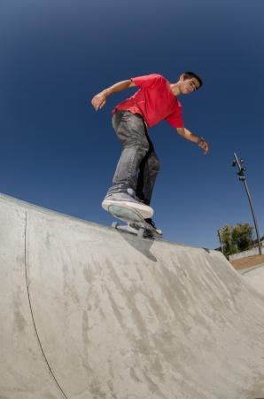 feeble: Skateboarder doing a BS feeble grind on a curb.