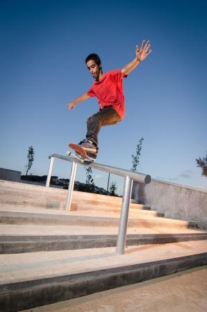 feeble: Skateboarder doing a FS Feeble on rail.