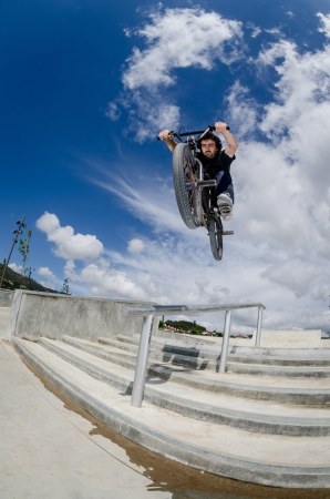 Bmx rider on a big air jump in a skate park. photo