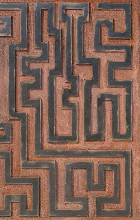 Metal rusty background, with geometrical shapes forming a labyrinth. photo