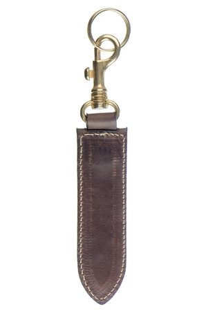 Leather key chain isolated on white background. photo