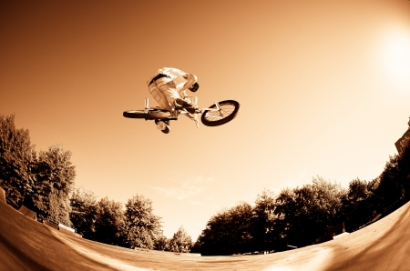 High BMX jump in a skate park. photo
