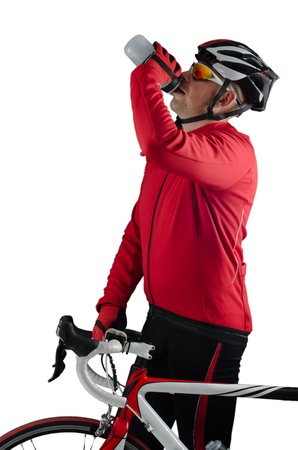 Cyclist drinking water isolated on white background.