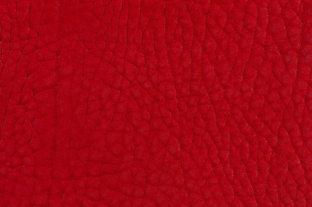 Red leather texture closeup detailed background. photo