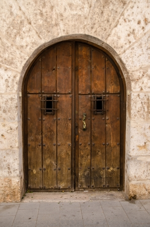 old wooden door: Old wooden door from medieval era. Stock Photo