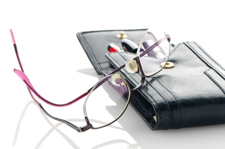 Leather notebook and glasses isolated on white background. photo