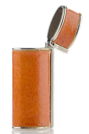 Orange lighter case on white reflective background. Stock Photo - 16050120