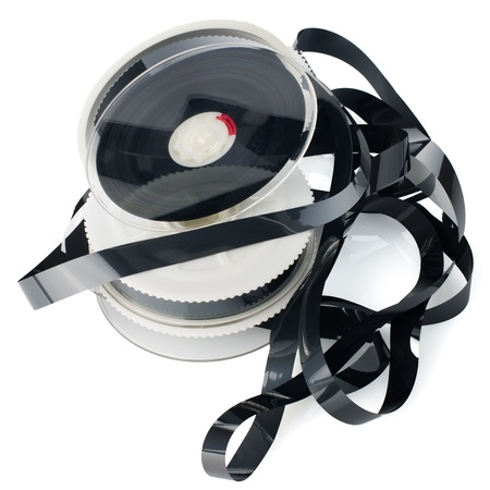 Pile of videotape reels on  white reflective background. photo