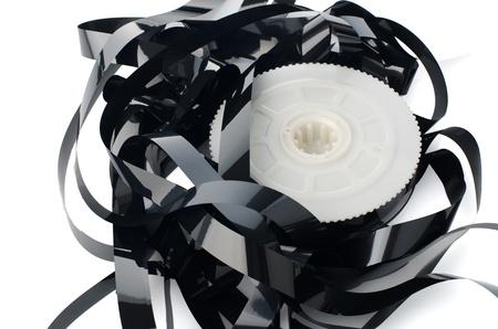 vhs videotape: Pile of videotape reels on  white reflective background.