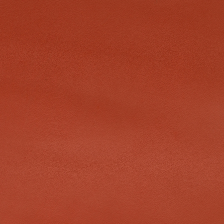 Red leather texture closeup backgroud. photo