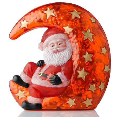 Santa Claus Christmas decoration on white reflective background. photo