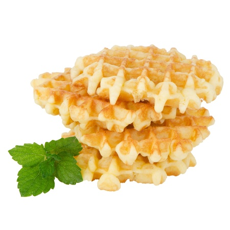 Pile of sweet waffles with green mint leaves isolated on white background. Stock Photo - 16291429