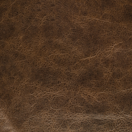Closeup detail on old brown leather texture background. photo