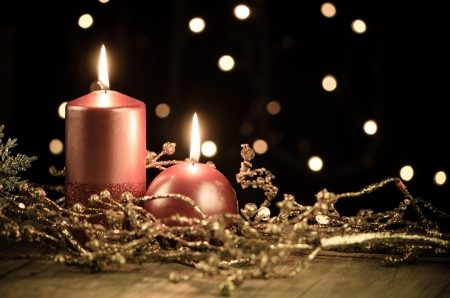 Christmas candles set against black background  photo