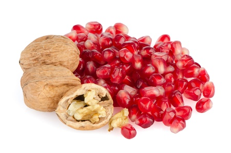 Pomegranate seed pile and nuts isolated on white background  photo