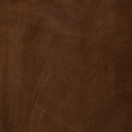 Brown leather texture closeup background. photo