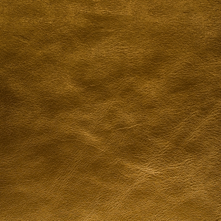 Closeup of golden color leather texture background  photo