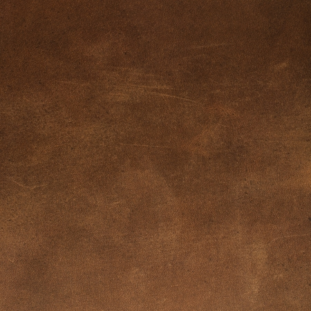color skin brown: Brown leather texture closeup. Useful as background for design-works.