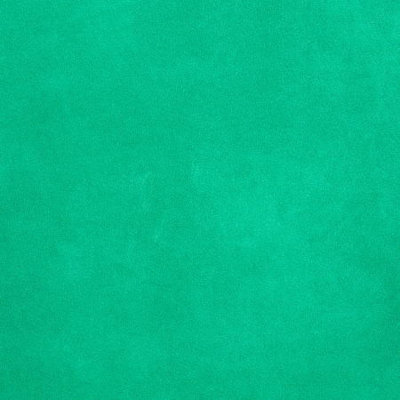 Closeup of natural background - green suede. photo