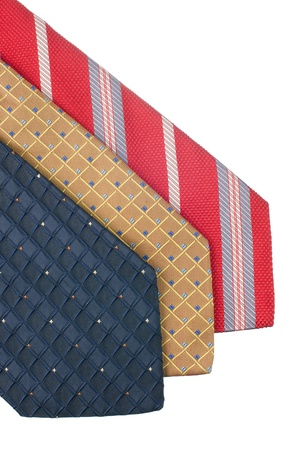 Closeup of three ties isolated on white background. photo