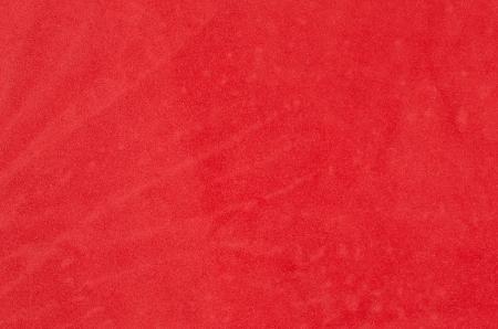 velvet texture: Closeup dettaglio di et� compresa tra sfondo rosso vellutato. Archivio Fotografico
