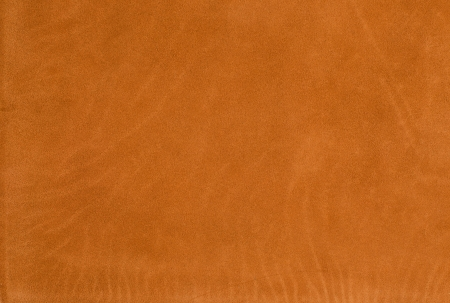 Closeup detail of orange leather texture background. photo