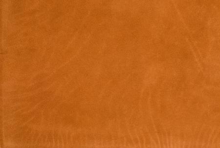 Closeup detail of orange leather texture background. photo