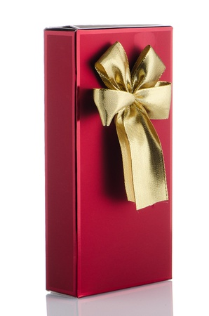 Red box with gold bow on white background. photo