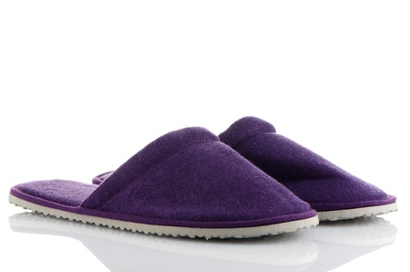 A pair of purple slippers on a white background.