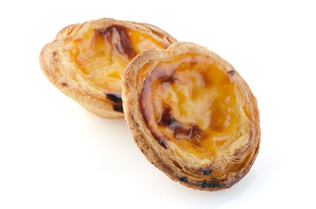 Pasteis de nata, typical pastry from Lisbon - Portugal, isolated on white background. Stock Photo - 17380110