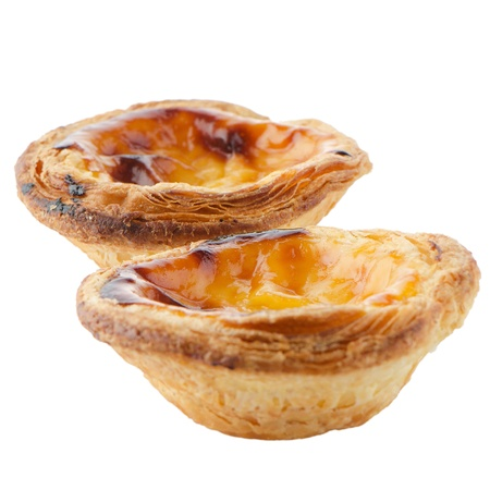 custard flavor: Pasteis de nata, typical pastry from Lisbon - Portugal, isolated on white background. Stock Photo